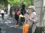 Phyllis handing out flyers to peole entering City Hall